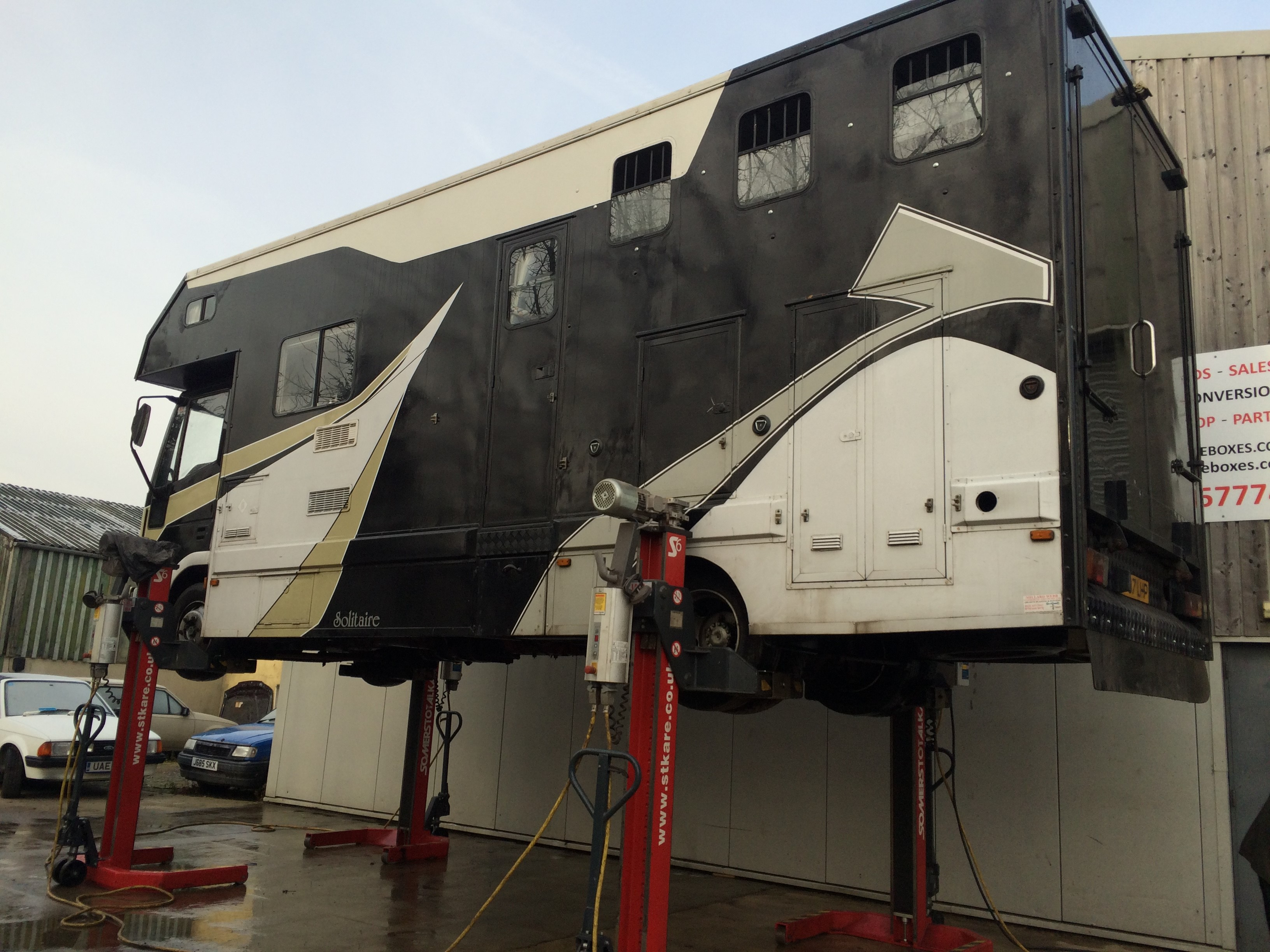 Horsebox being Serviced up on ramps